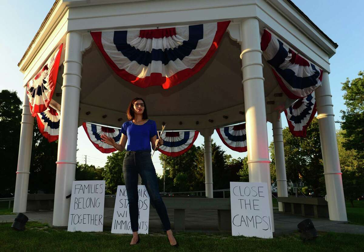 The Norwalk DTC organizes a vigil on the Norwalk Green in protest of the Trump administration's border policies Friday, July 12, 2019, in Norwalk, Conn. The Vigil was held in conjunction with similar demonstrations around Fairfield County.