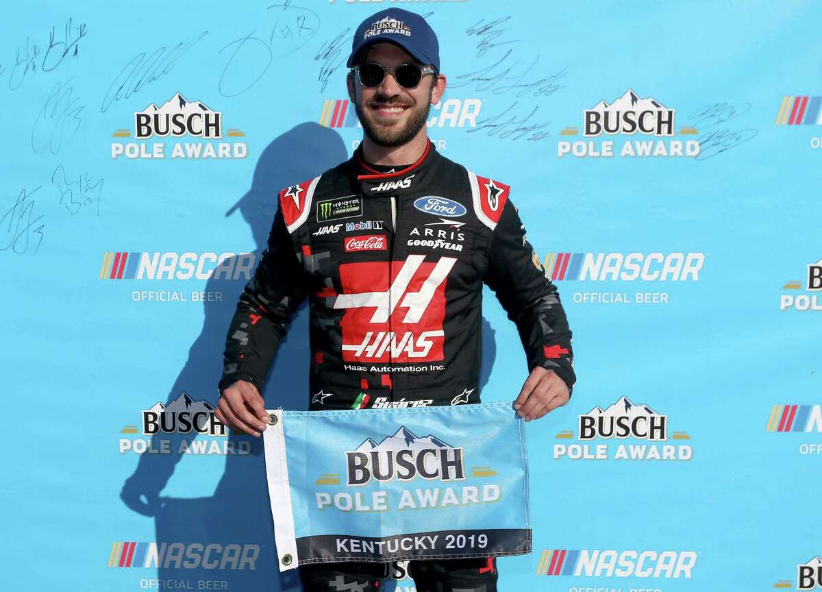 SPARTA, KENTUCKY - JULY 12: Daniel Suarez, driver of the #41 Haas Automation Ford, celebrates with the Busch Pole Award after qualifying for the Monster Energy NASCAR Cup Series Quaker State 400 Presented by Walmart at Kentucky Speedway on July 12, 2019 in Sparta, Kentucky. (Photo by Brian Lawdermilk/Getty Images)