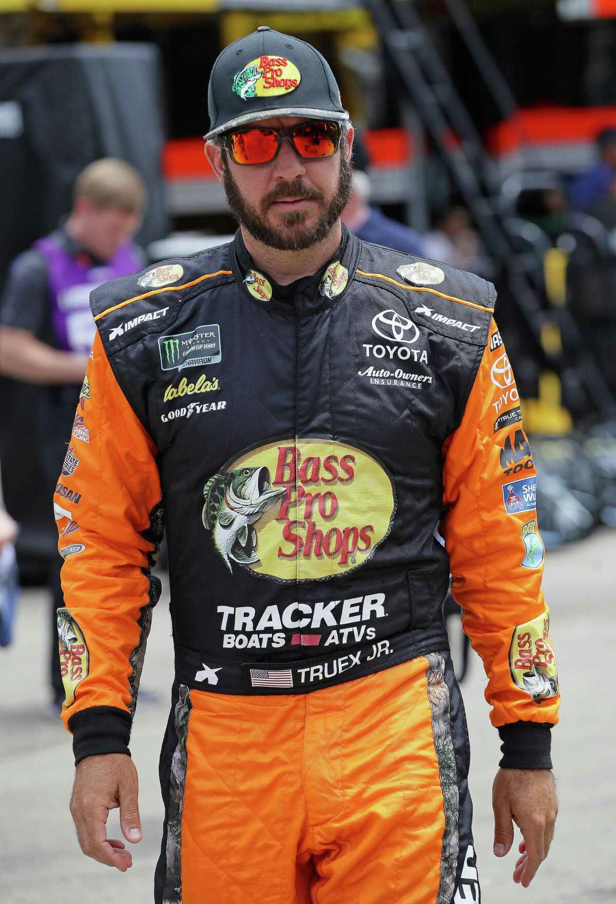 JOLIET, ILLINOIS - JUNE 29: Martin Truex Jr., driver of the #19 Bass Pro Shops Toyota, walks to his car before practice for the Monster Energy NASCAR Cup Series Camping World 400 at Chicagoland Speedway on June 29, 2019 in Joliet, Illinois. (Photo by Jonathan Daniel/Getty Images)