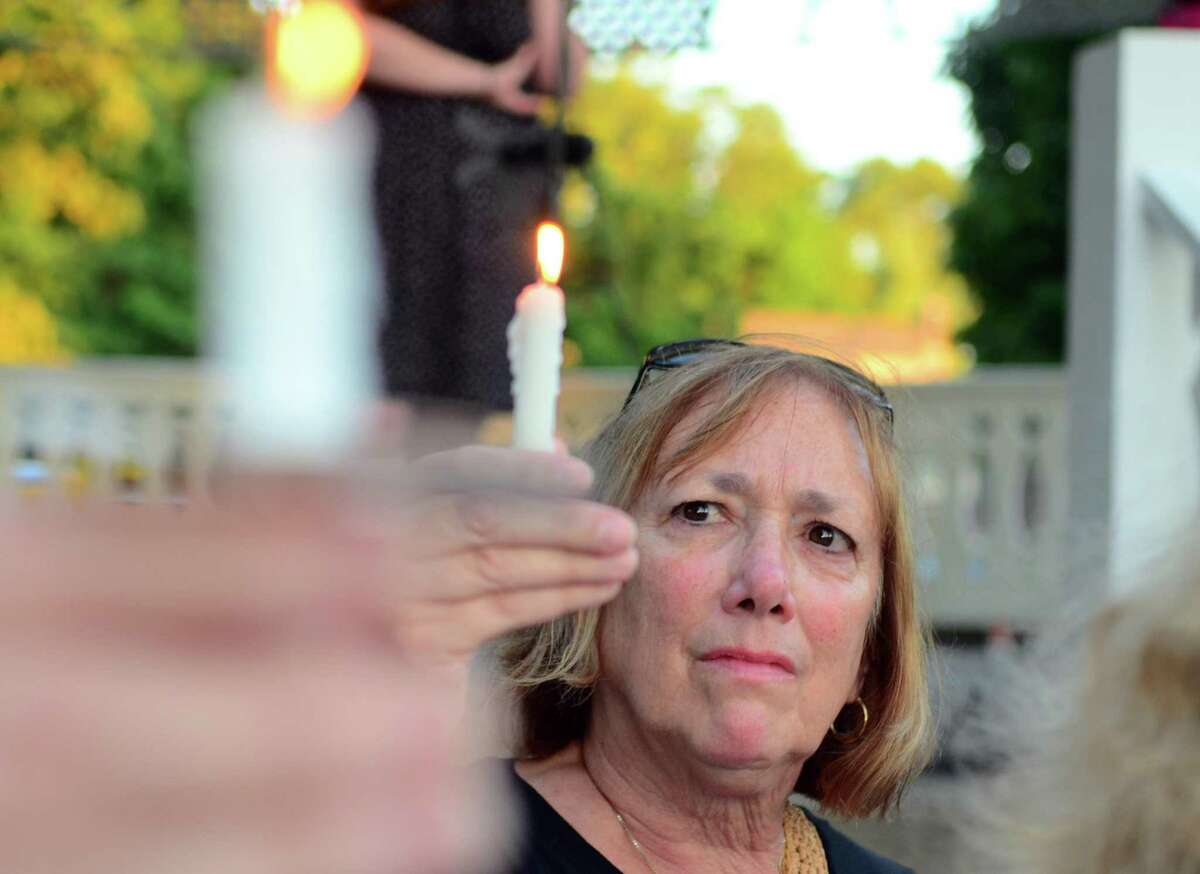 Area residents take part in a Lights for Liberty vigil held on Sherman Green in Fairfield, Conn., on Friday July 12, 2019. This is one of as many as 700 Lights for Liberty events happening nationwide as a movement to end the human detention camps for immigrants seeking asylum.