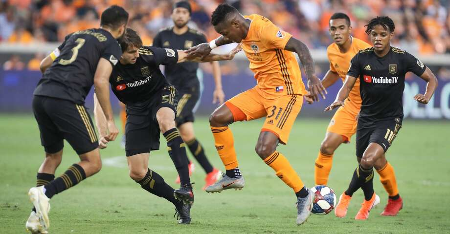 Houston Dynamo forward Romell Quioto (31) battles Los Angeles FC defenders to keep control of the ball during the first half of an MLS soccer match Friday, July 12, 2019, in Houston. Photo: Steve Gonzales/Staff Photographer