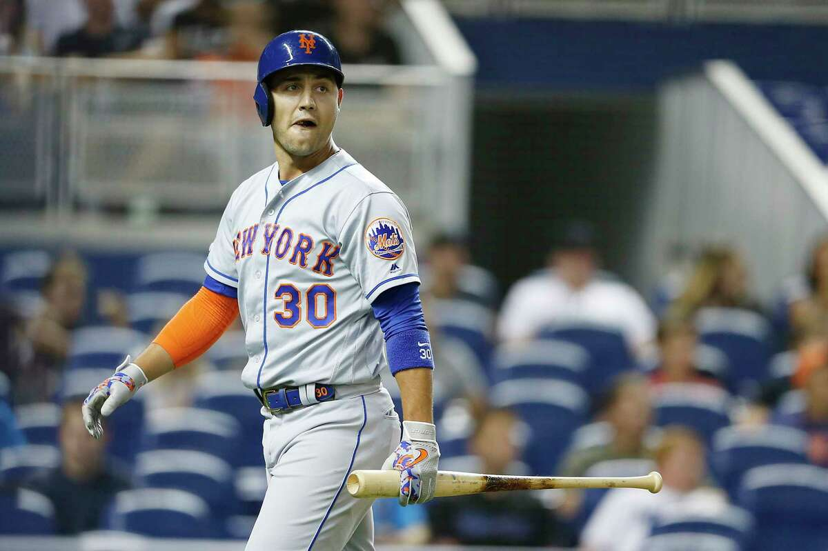 MIAMI, FLORIDA - JULY 12: Michael Conforto #30 of the New York Mets reacts after striking out in the third inning against the Miami Marlins at Marlins Park on July 12, 2019 in Miami, Florida. (Photo by Michael Reaves/Getty Images)