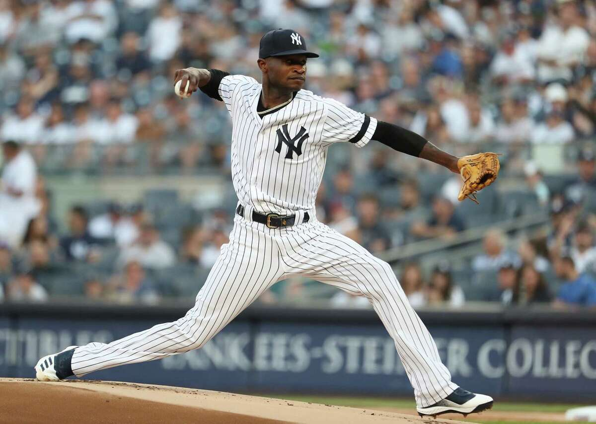 NEW YORK, NEW YORK - JULY 12: Domingo German #55 of the New York Yankees pitches against the Toronto Blue Jays during their game at Yankee Stadium on July 12, 2019 in New York City. (Photo by Al Bello/Getty Images)
