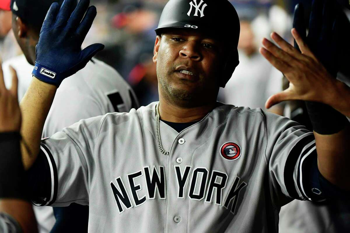 ST. PETERSBURG, FLORIDA - JULY 04: Edwin Encarnacion #30 of the New York Yankees celebrates with teammates after hitting a homer off of Yonny Chirinos #72 of the Tampa Bay Rays in the seventh inning of a baseball game at Tropicana Field on July 04, 2019 in St. Petersburg, Florida. (Photo by Julio Aguilar/Getty Images)