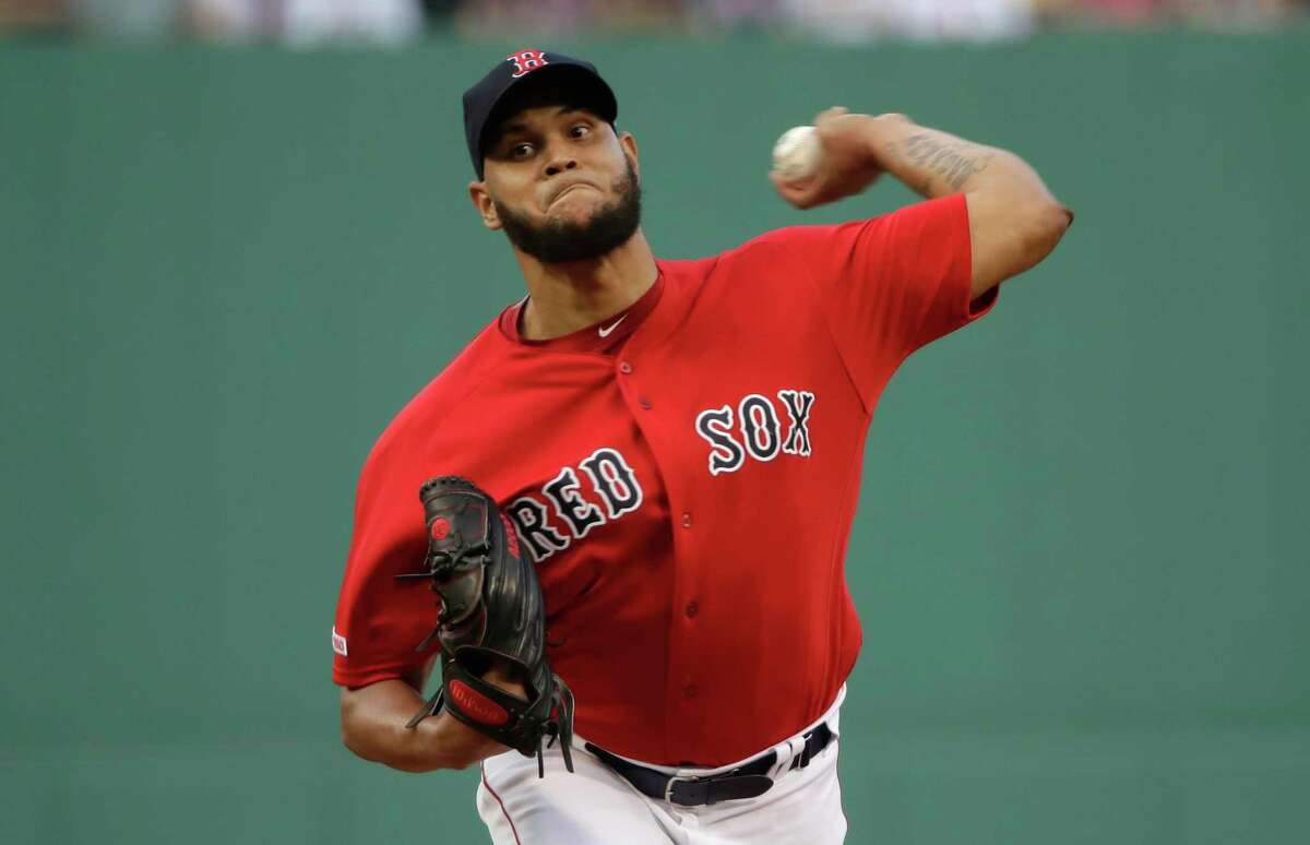 Boston Red Sox starting pitcher Eduardo Rodriguez delivers to a Los Angeles Dodgers batter during the first inning of a baseball game at Fenway Park, Friday, July 12, 2019, in Boston. (AP Photo/Elise Amendola)