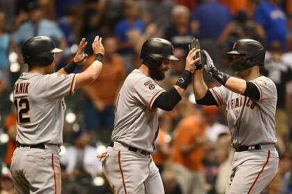 Giants overcome Smith's first blown save, win on Posey's grand slam