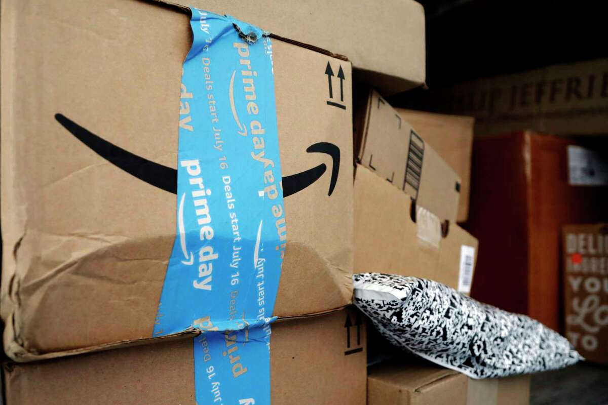 FILE - In this July 17, 2018, file photo Amazon Prime packages sit in an UPS delivery truck before being unloaded in Miami. Amazona€™s a€œPrime Daya€ is back. The made-up holiday, first launched in 2015, has become one of Amazona€™s busiest shopping days, offering discounts on gadgets, TVs and other goods. (AP Photo/Lynne Sladky, File)