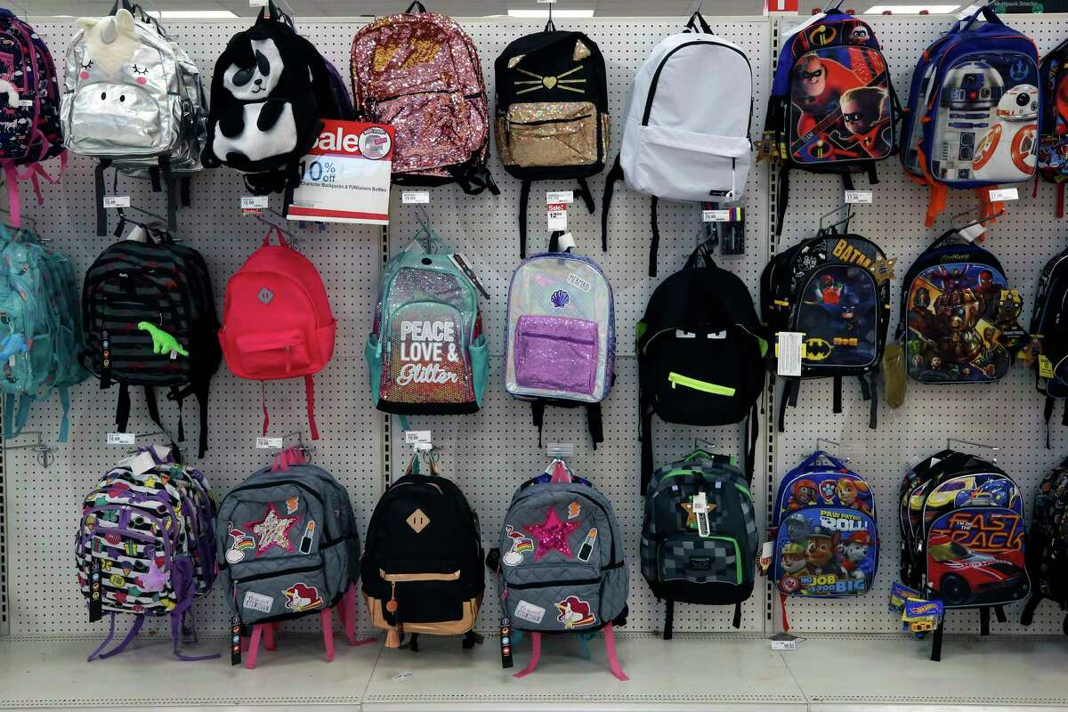 FILE - This July 18, 2018, photo shows a display of back to school backpacks in a Target store in Pittsburgh. For backpacks, Mary Hunt, founder of the website Cheapskate Monthly, recommends Jansport or Eastpak for durability. If you are shopping resale, those are labels to look for because theya€™ll last longer. (AP Photo/Gene J. Puskar, File)