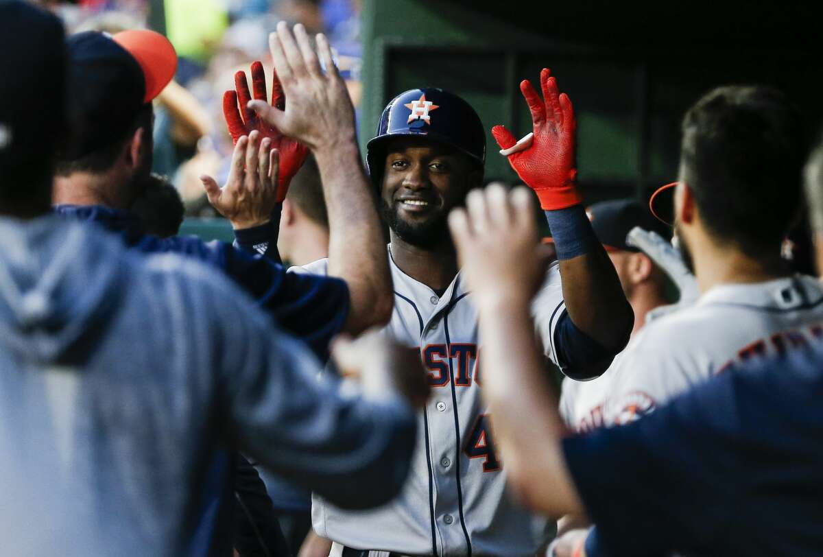Houston Astros' Yordan Alvarez is congratulated by teammates after hitting a solo home run during the sixth inning of a baseball game against the Texas Rangers, Friday, July 12, 2019, in Arlington, Texas. (AP Photo/Brandon Wade)