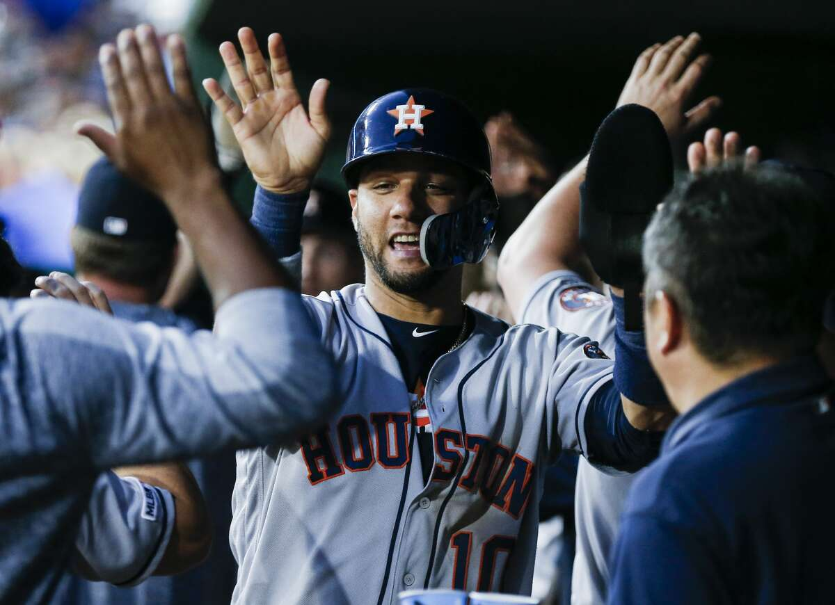 Houston Astros' Yuli Gurriel (10) is congratulated by teammates after scoring on a two-RBI single hit by Tyler White during the sixth inning of a baseball game against the Texas Rangers, Friday, July 12, 2019, in Arlington, Texas. (AP Photo/Brandon Wade)