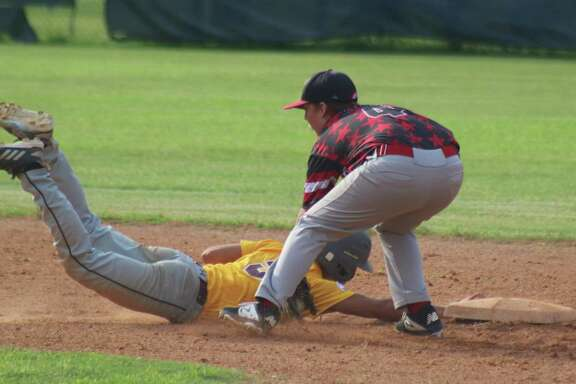 Pasadena Pony All-Star second baseman Logan King nearly tags out Dylan Barnard in Friday night's game at Bay Area Park. King would go on to get the win on the mound after pitching three quality innings.