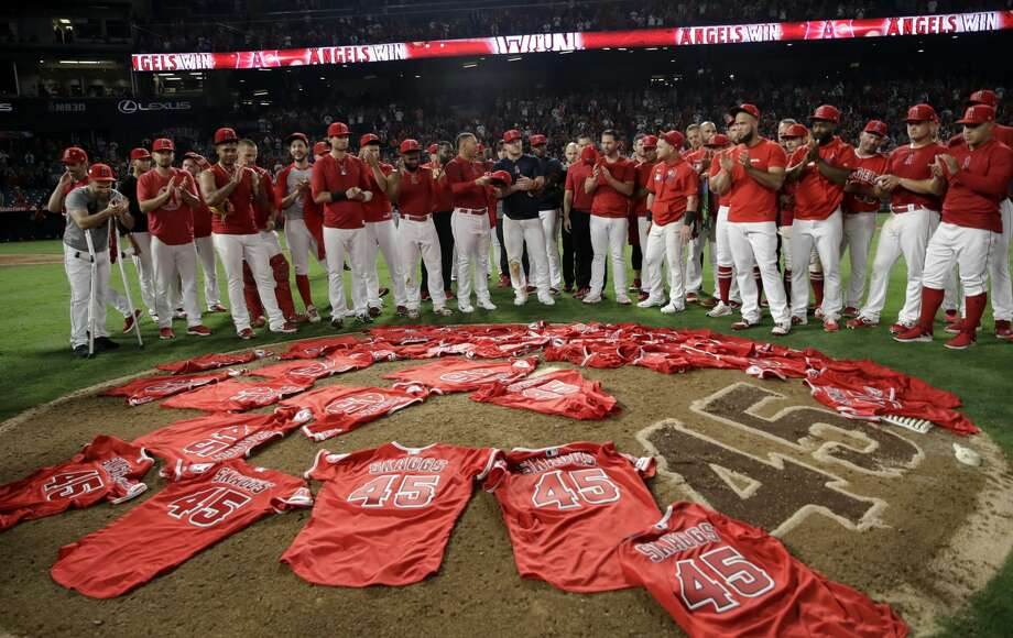 Members of the Los Angeles Angels place their jerseys with No. 45 in honor of pitcher Tyler Skaggs on the mound after a combined no-hitter against the Seattle Mariners during a baseball game Friday, July 12, 2019, in Anaheim, Calif. The Angels won 13-0. (AP Photo/Marcio Jose Sanchez) Photo: Marcio Jose Sanchez/Associated Press