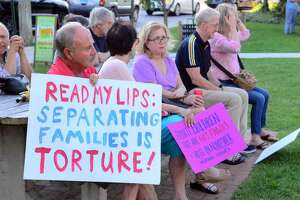 Area residents take part in a Lights for Liberty vigil held on Sherman Green in Fairfield., on Friday July 12.This is one of as many as 700 Lights for Liberty events happening nationwide as a movement to end the human detention camps for immigrants seeking asylum.