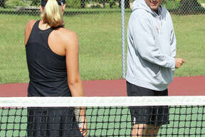Edwardsville coach Dave Lipe, shown talking with the Tigers' Hannah Colbert during a match last season, is the 2018 Telegraph Girls Tennis Coach of the Year.