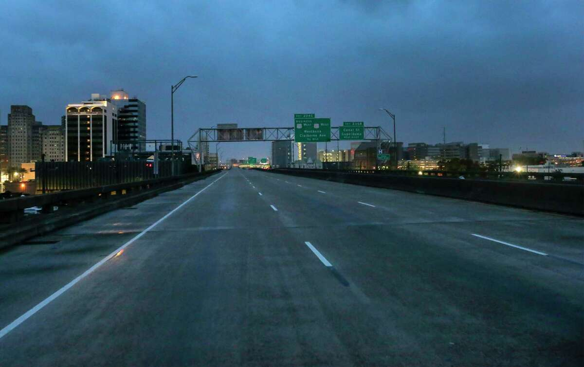 The I-10 in New Orleans is nearly empty of traffic as the eye of Tropical Storm Barry nears the Louisiana southwest coast near Morgan City Saturday, July 13, 2019. (David Grunfeld/The Advocate via AP)