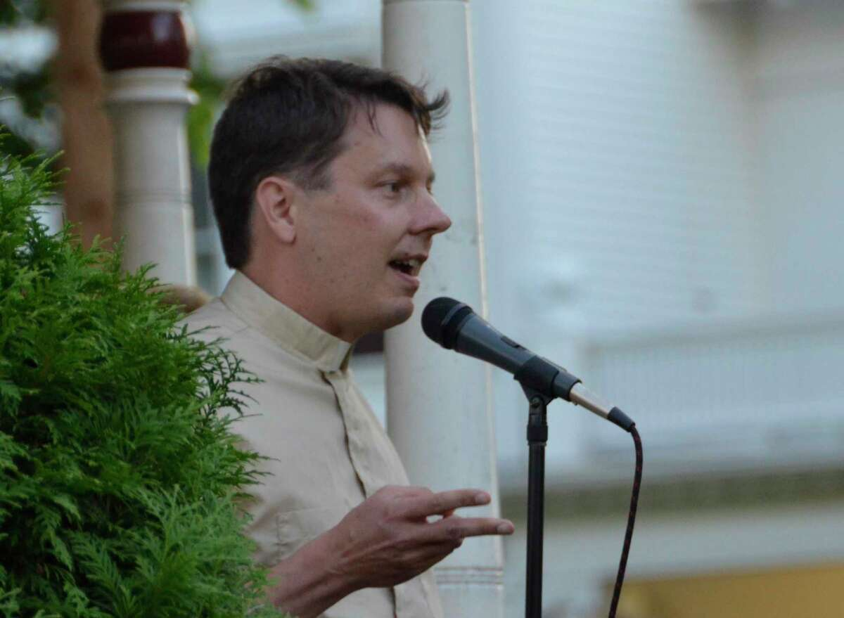 The Rev. Chris Files of the Trinity Lutheran Church in Milford speaks during the Lights for Liberty event in Milford July 12.