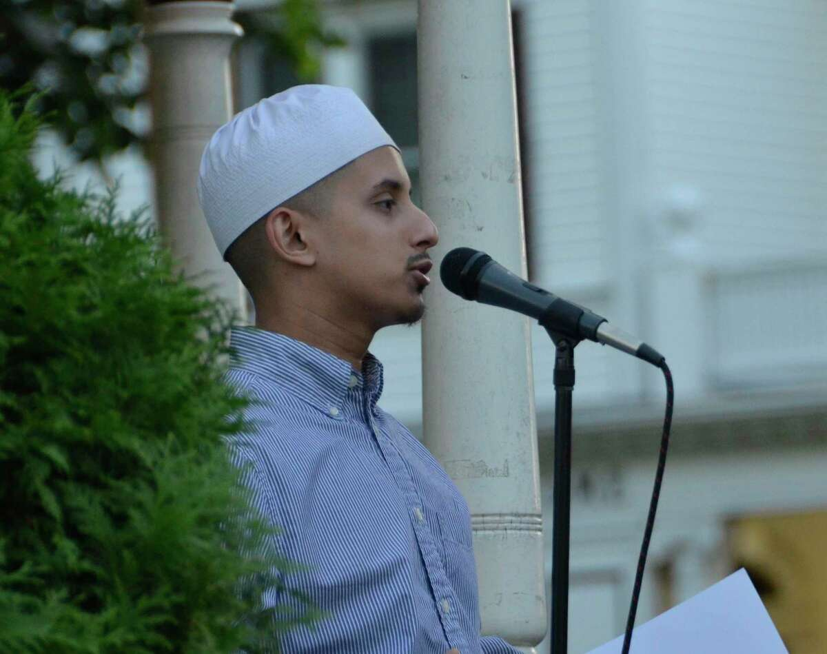 Zain A. Seyal, of the Muslim Youth of Connecticut, speaks during the Lights for Liberty vigil July 12, 2019 in Milford, Conn.