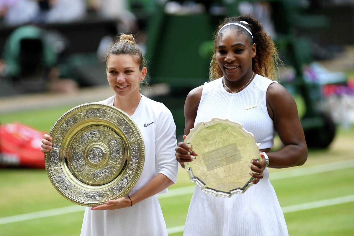 LONDON, ENGLAND - JULY 13: Simona Halep of Romania, winner and Serena Williams of The United States, runner-up pose for a photo with their respective trophies after the Ladies' Singles final during Day twelve of The Championships - Wimbledon 2019 at All England Lawn Tennis and Croquet Club on July 13, 2019 in London, England.