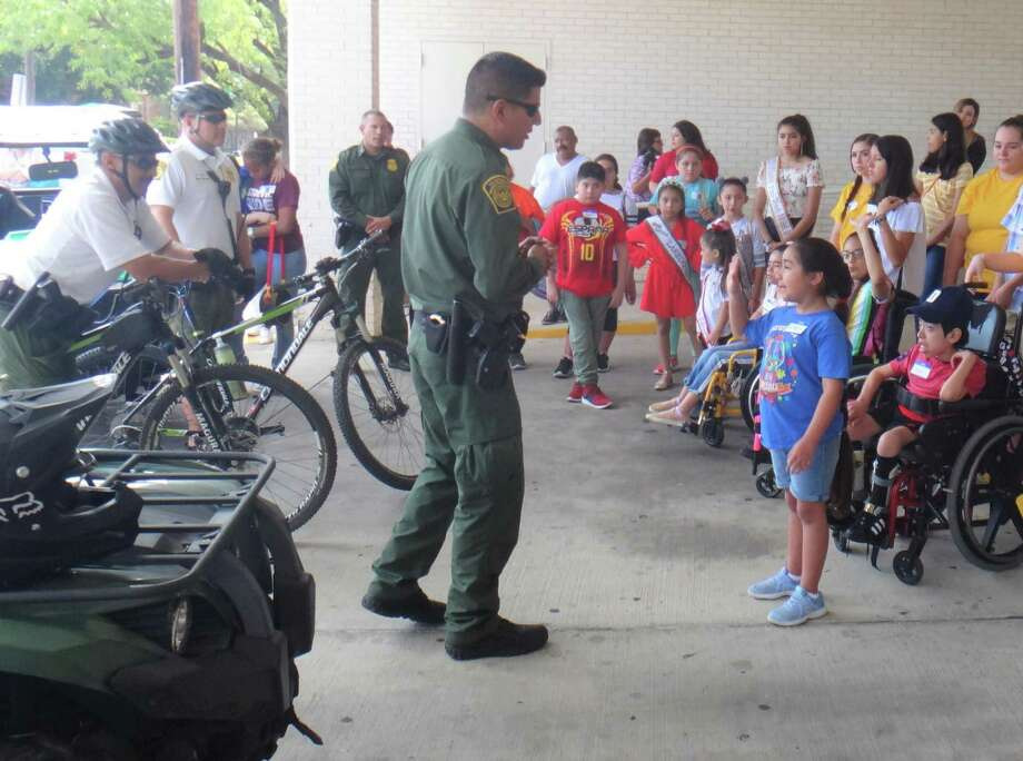 Border Patrol agents give kids first-hand look at their different vehicles and equipment. Photo: Courtesy Photo
