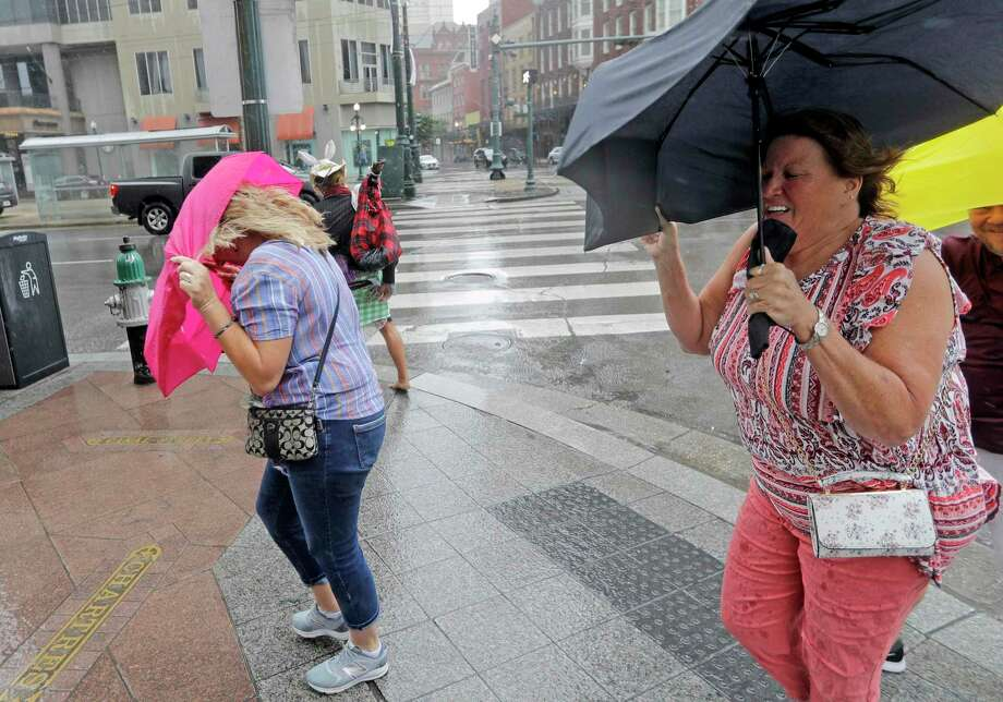 Martha Young, right, and Patricia Plishka battle the wind and rain from Hurricane Barry as it nears landfall Saturday, July 13, 2019, in New Orleans. (AP Photo/David J. Phillip) Photo: David J. Phillip, STF / Associated Press / Copyright 2019 The Associated Press. All rights reserved
