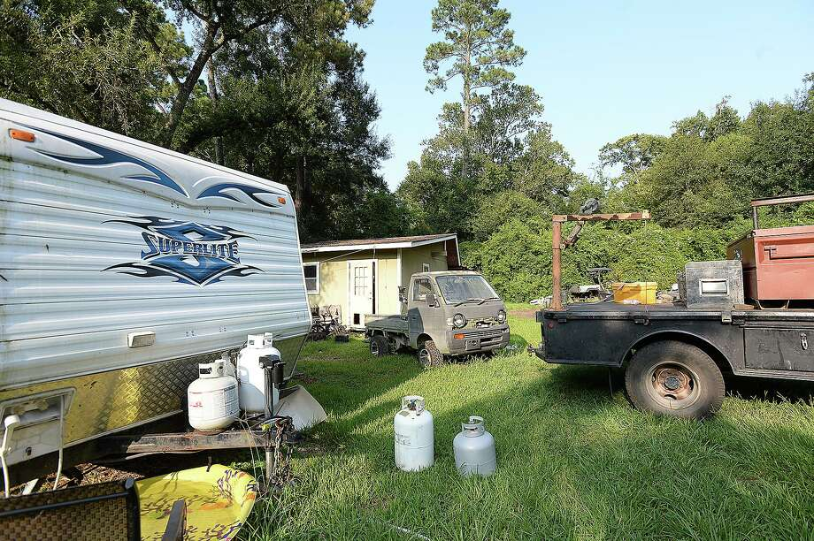The backyard of the Allison home on Third Street in Vidor is filled with vehicles awaiting repair, family items and the two trailers the family of five is still living in as they slowly recovder from the flodding of Harvey.  Wednesday, August 22, 2018  Kim Brent/The Enterprise Photo: Kim Brent / The Enterprise / BEN