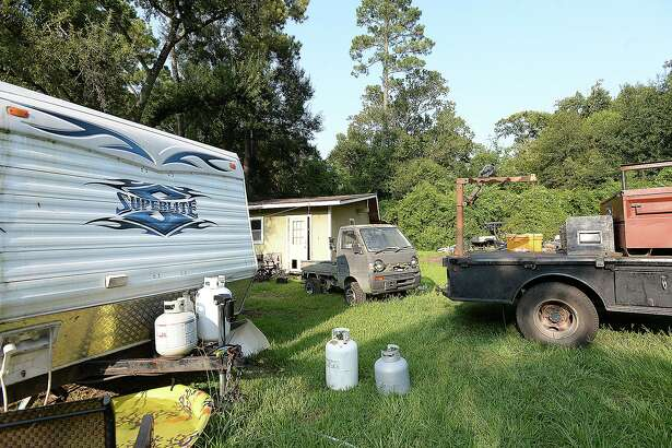 The backyard of the Allison home on Third Street in Vidor is filled with vehicles awaiting repair, family items and the two trailers the family of five is still living in as they slowly recovder from the flodding of Harvey. Wednesday, August 22, 2018 Kim Brent/The Enterprise