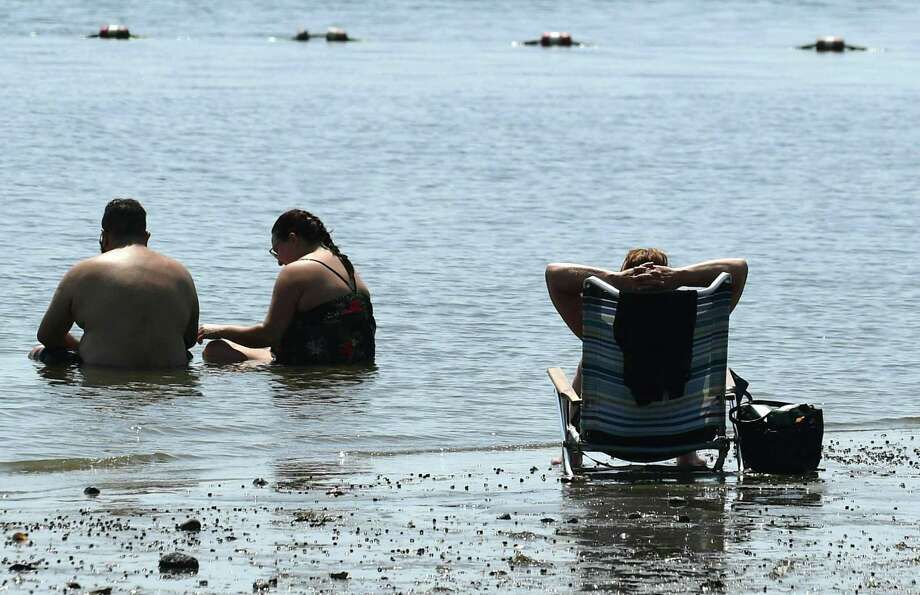 Beachgoers cool off in the waters at Calf Pasture Beach Tuesday, July 9, 2019, in Norwalk, Conn. Photo: Erik Trautmann / Hearst Connecticut Media / Norwalk Hour