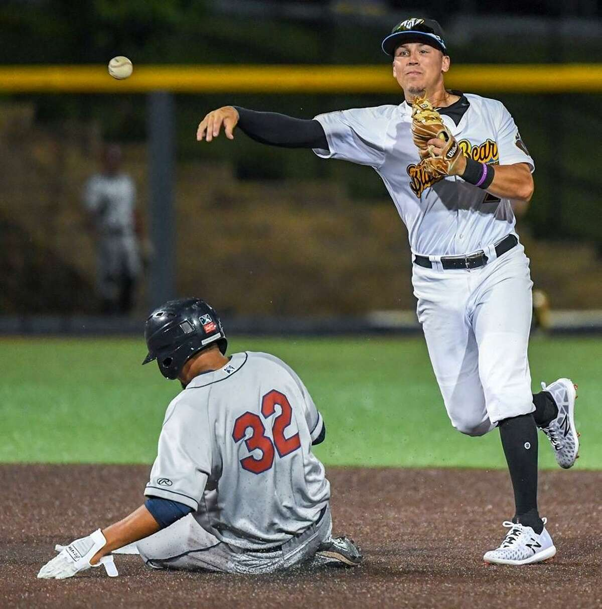 New Haven's Dean Lockery tries to turn a double play in recent game for Class A short-season West Virginia.