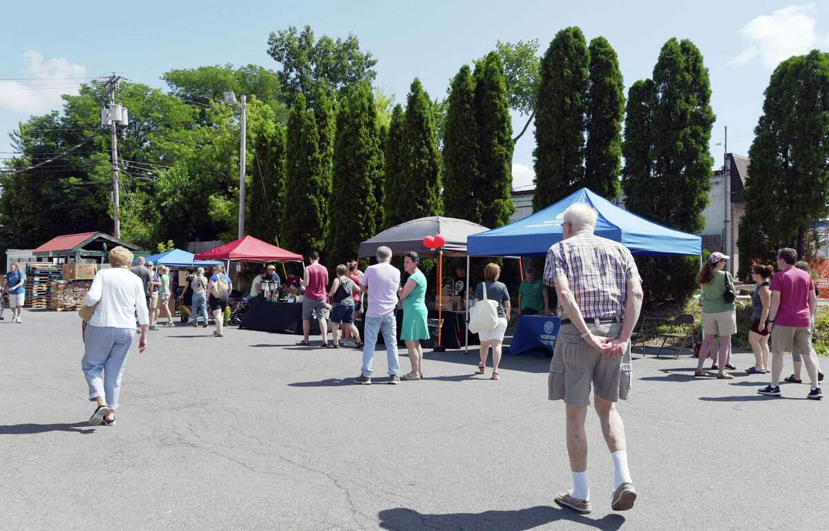 People browse various vendors during the inaugural Niskayuna Farmers Market at the Co-Op on Saturday, July 13, 2019 in Niskayuna, NY. (Phoebe Sheehan/Times Union)