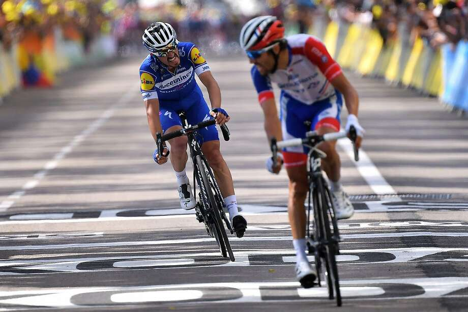 French riders Julian Alaphilippe (left) and Thibaut Pinot encourage each other at the finish line of Stage 8. Photo: MARCO BERTORELLO;Marco Bertorello / AFP / Getty Images