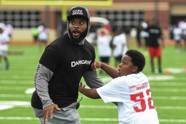 Elandon Roberts runs a drill with kids during his annual heart walk and youth football camp at Memorial High School Saturday morning. Photo taken on Saturday, 07/13/19. Ryan Welch/The Enterprise
