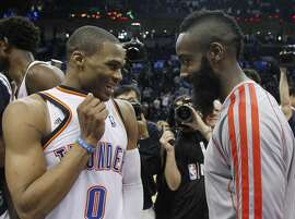 Oklahoma City Thunder guard Russell Westbrook (0) and Houston Rockets guard James Harden, right, talk following their an NBA basketball game in Oklahoma City, Wednesday, Nov. 28, 2012. Oklahoma City won 120-98. (AP Photo/Sue Ogrocki)