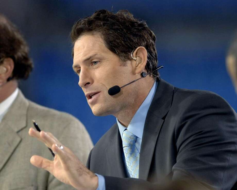 ESPN commentator Steve Young on Monday Night Football Nov. 13, 2006 as the Carolina Panthers host the Tampa Bay Buccaneers  in Charlotte.  The Panthers won 24 - 10.  (Photo by Al Messerschmidt/Getty Images) Photo: Al Messerschmidt, Getty Images / Getty Images North America