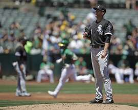 Chicago White Sox pitcher Ross Detwiler, right, waits for the bases to clear after giving up a three-run home run to Oakland Athletics' Franklin Barreto in the first inning of a baseball game Saturday, July 13, 2019, in Oakland, Calif. (AP Photo/Ben Margot)