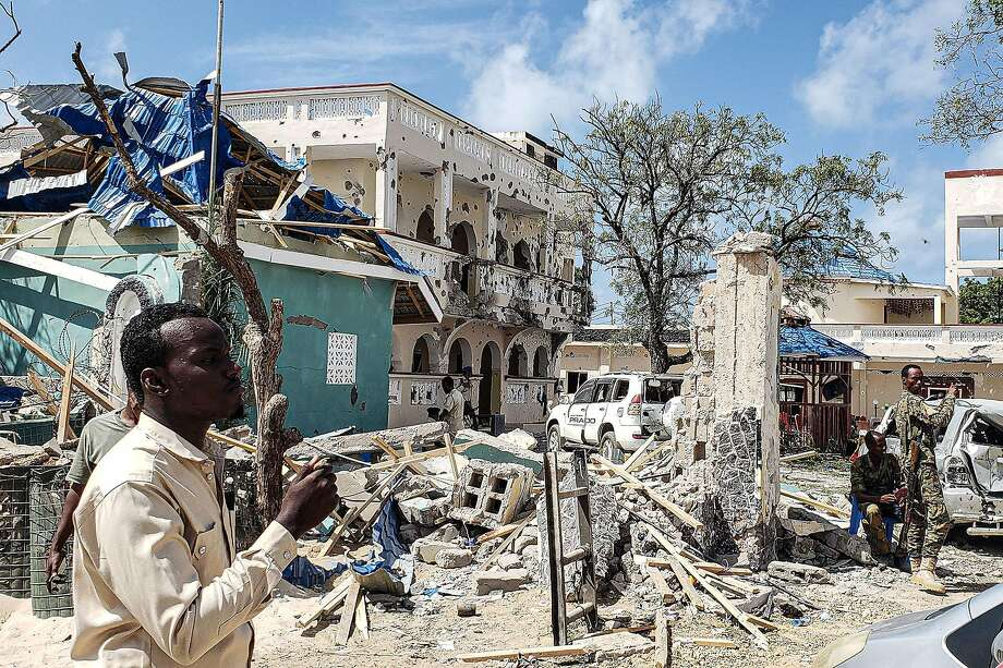 A man passes rubble of a hotel in Kismayo, Somalia, in 2019, a day after 26 people were killed in an attack by Al-Shabab. Photo: Agence France Press / Tribune News Service