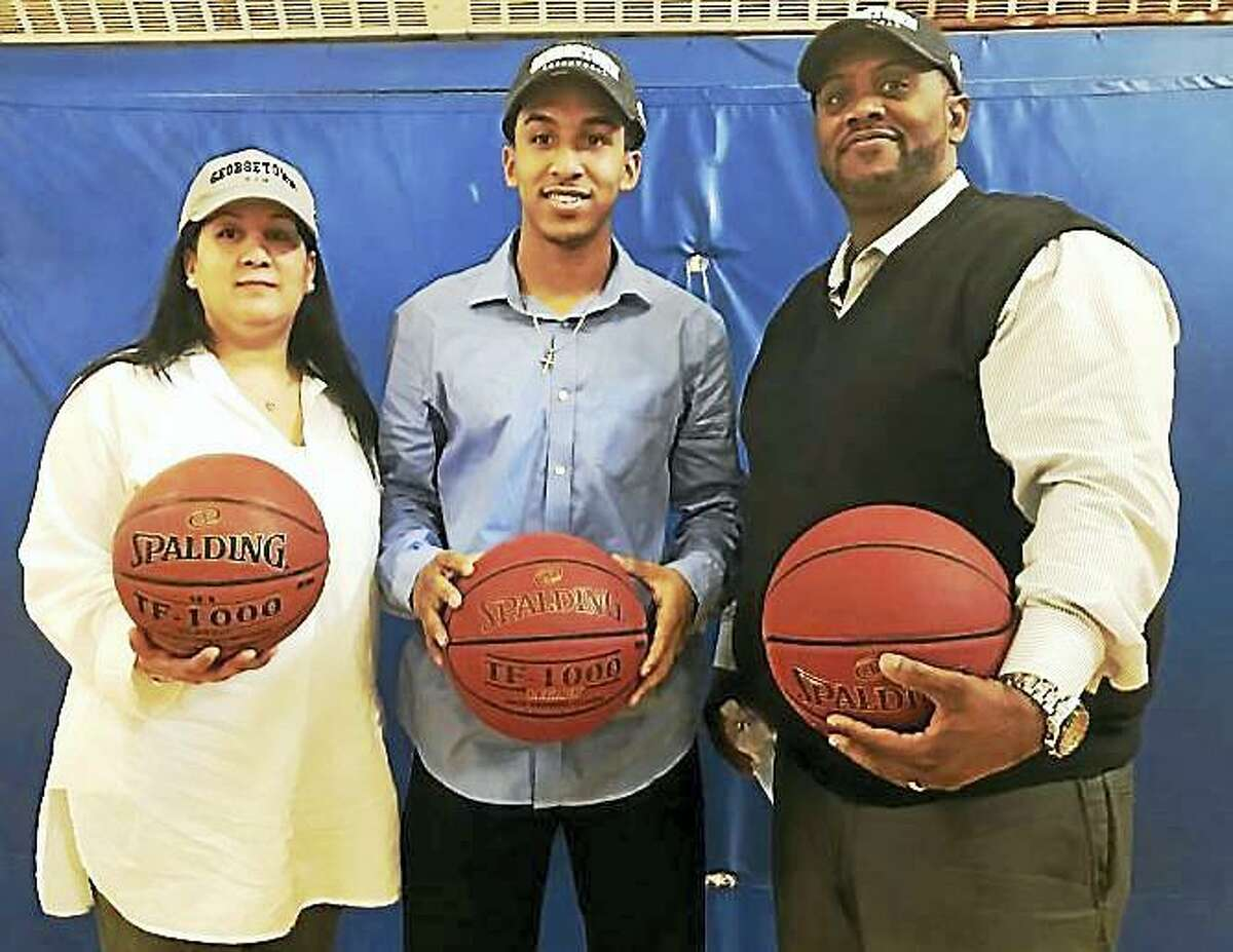 Notre Dame-West Haven's Tremont Waters with his parents, Vanessa and Edward Waters, on Oct. 19, 2016.