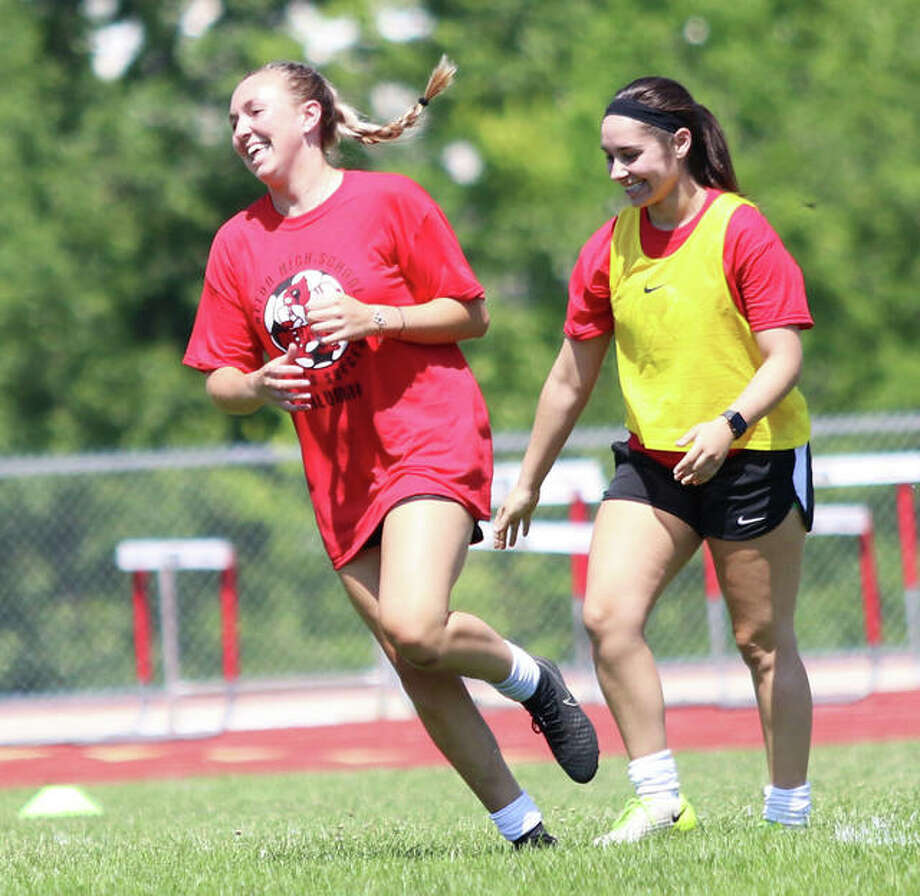 Annie Evans (left) reacts after scoring the game's first goal Saturday afternoon in the Alton Redbirds girls soccer alumni game at Piasa Motor Fuels Field at Alton High in Godfrey. Evans, a 2017 grad, scored two goals. Photo: Greg Shashack | The Telegraph