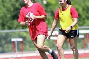 Annie Evans (left) reacts after scoring the game's first goal Saturday afternoon in the Alton Redbirds girls soccer alumni game at Piasa Motor Fuels Field at Alton High in Godfrey. Evans, a 2017 grad, scored two goals.