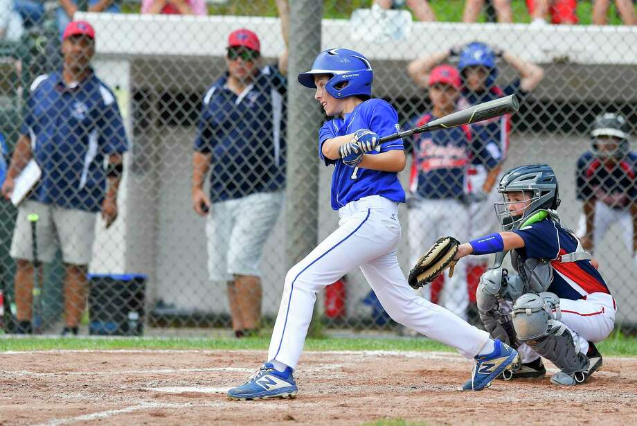 Darien's Aidan Elders follows his two run double in the third inning against Stamford North in the District 1 Little League championship game at Drotar Park in Stamford, Conn. on July 13, 2019. Darien defeated Stamford North 12-2 (5 innings). Photo: Matthew Brown / Hearst Connecticut Media / Stamford Advocate