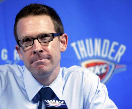 FILE - This Sept. 24, 2010 file photo shows Oklahoma City Thunder general manager Sam Presti smiling as he talks with the media in Oklahoma City. This year's Western Conference finals opponents share a link _ Presti, a former Spurs executive. (AP Photo/Sue Ogrocki, File)