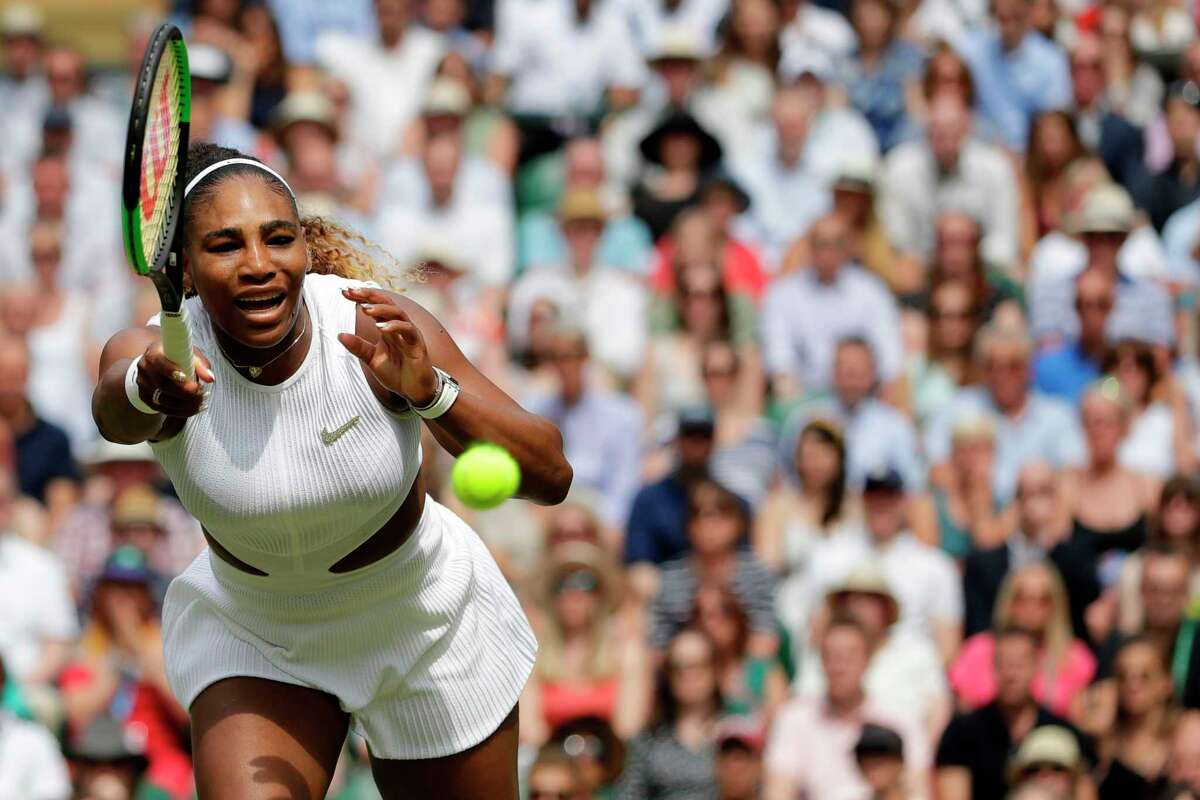 US player Serena Williams returns against Romania's Simona Halep during their women's singles final on day twelve of the 2019 Wimbledon Championships at The All England Lawn Tennis Club in Wimbledon, southwest London, on July 13, 2019. (Photo by Ben Curtis / POOL / AFP) / RESTRICTED TO EDITORIAL USEBEN CURTIS/AFP/Getty Images