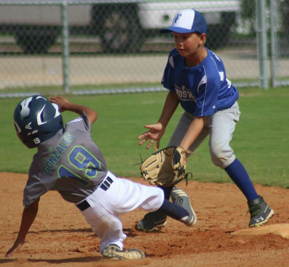 There was plenty of action around second base Saturday morning as Friendswood Blue's defense up the middle was top-notch. Photo: Robert Avery