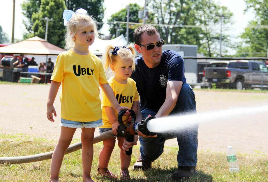 Ubly gives kids a free day out during Ubly's Homecoming. There was a kiddie parade at the start, with free activities afterwards. Photo: Andrew Mullin/Huron Daily Tribune