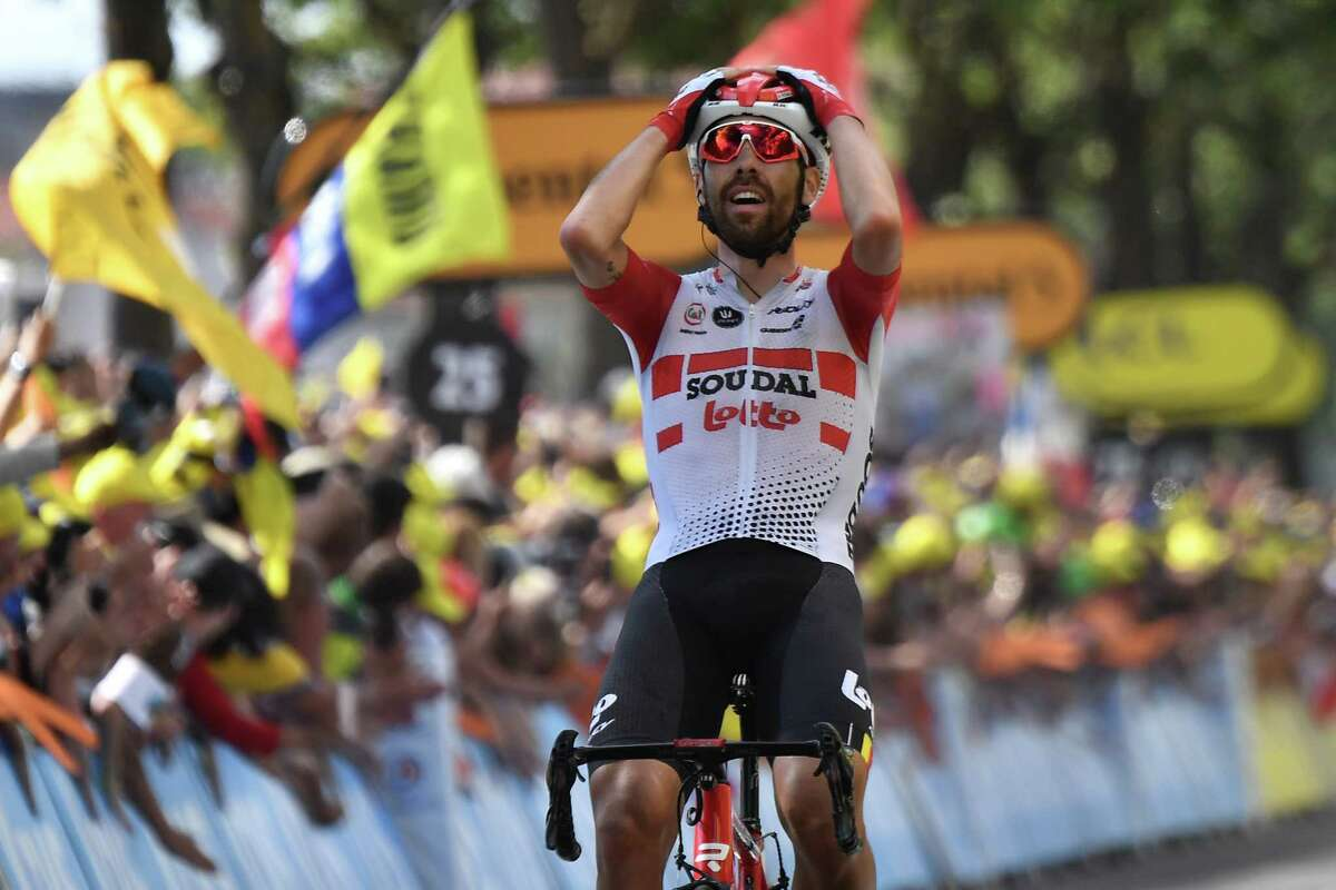 Belgium's Thomas De Gendt celebrates as he wins on the finish line of the eighth stage of the 106th edition of the Tour de France cycling race between Macon and Saint-Etienne, in Saint-Etienne, eastern France, on July 13, 2019. (Photo by JEFF PACHOUD / AFP)JEFF PACHOUD/AFP/Getty Images