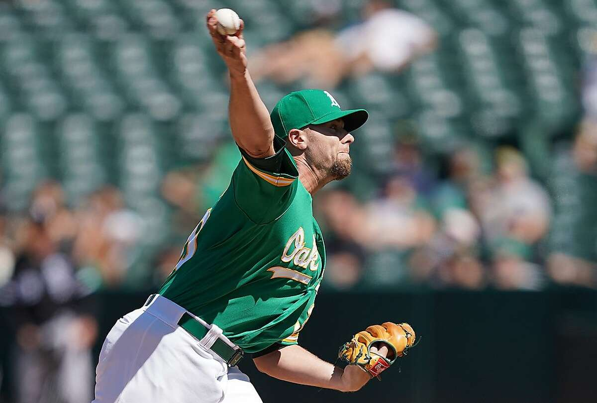 OAKLAND, CA - JULY 13: Blake Treinen #39 of the Oakland Athletics pitches against the Chicago White Sox in the top of the seventh inning at Ring Central Coliseum on July 13, 2019 in Oakland, California. The Athletics won the game 13-2. (Photo by Thearon W. Henderson/Getty Images)