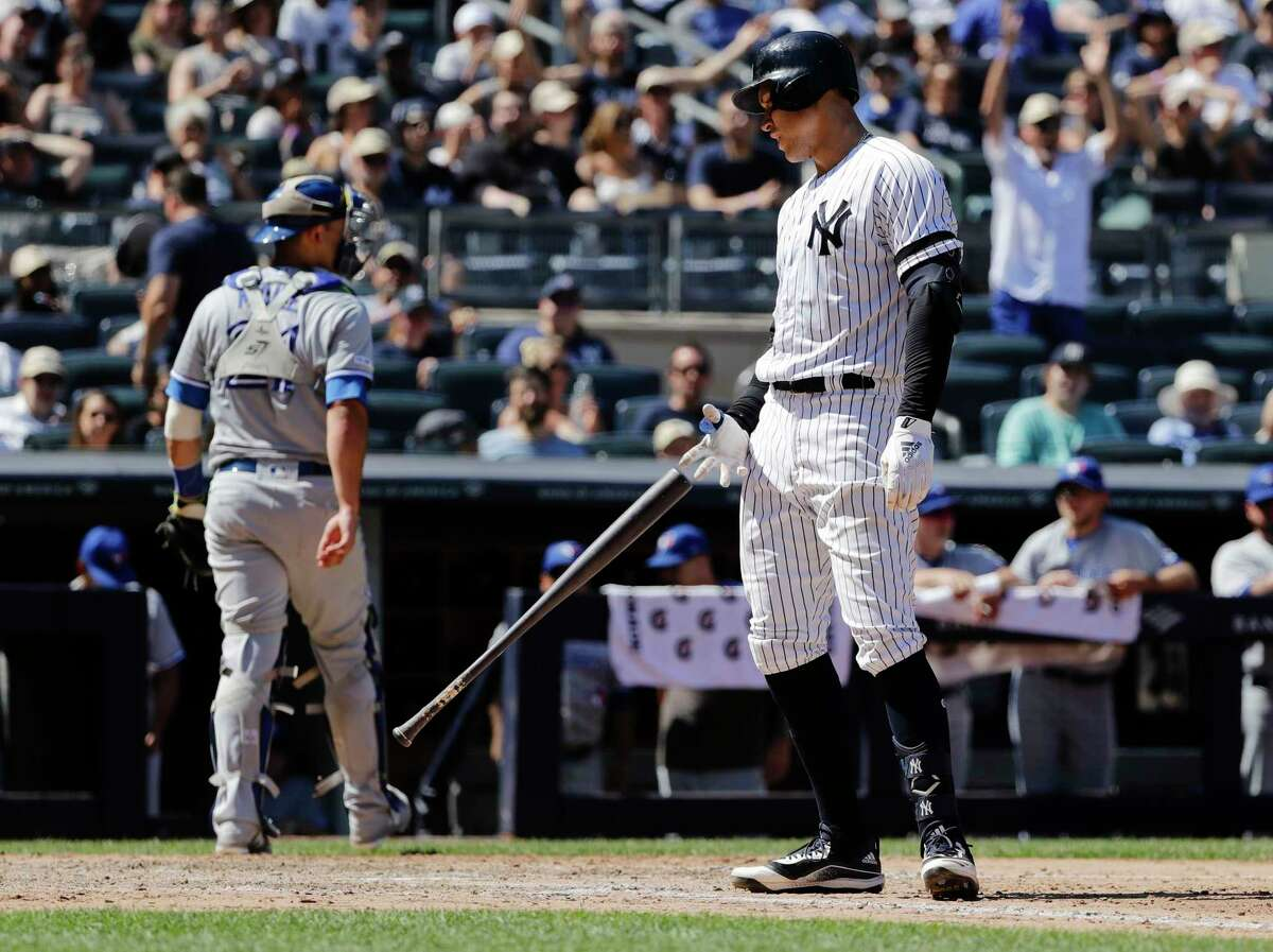 New York Yankees' Aaron Judge, right, reacts after striking out as Toronto Blue Jays catcher Luke Maile, left, heads back to the dugout after the seventh inning of a baseball game Saturday, July 13, 2019, in New York. The Blue Jays won 2-1.(AP Photo/Frank Franklin II)