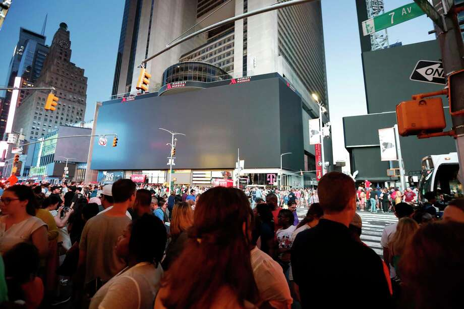 Screens in Time Square are black during a widespread power outage, Saturday, July 13, 2019, in the Manhattan borough of New York. Authorities say a transformer fire caused a power outage in Manhattan and left businesses without electricity, elevators stuck and subway cars stalled. Photo: Michael Owens, AP / Copyright 2019 The Associated Press. All rights reserved