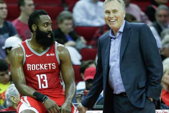 Rockets guard James Harden (13) and coach Mike D'Antoni laugh during a timeout in the second half of an against the Denver Nuggets at Toyota Center on March 28, 2019, in Houston.