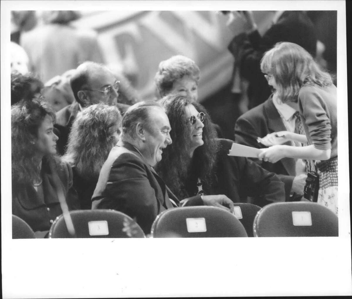 Albany, New York - Former New York Governor Hugh Carey sits with celebrity Disc Jockey Howard Stern as a Stern fan asks for an autograph. January 1, 1995 (John Carl D'Annibale/Times Union Archive)