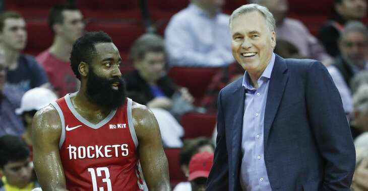 Houston Rockets guard James Harden (13) and Rockets head coach Mike D'Antoni laugh during a time out in the second half of an NBA basketball game against the Denver Nuggets at Toyota Center on Thursday, March 28, 2019, in Houston.